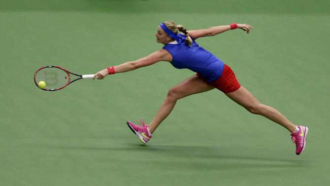 Czech Republic's Petra Kvitova returns the ball to France's Caroline Garcia during their semi-final match of the Fed Cup tennis tournament in Ostrava
