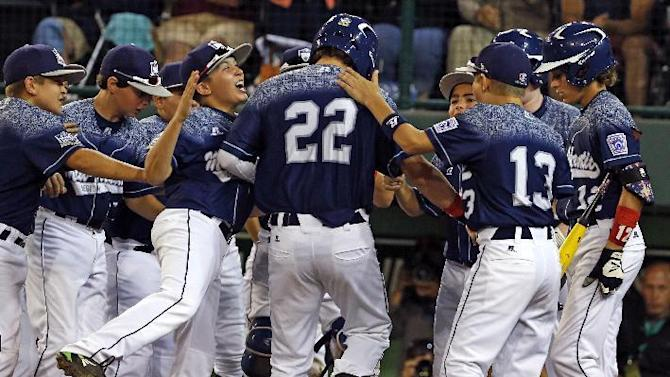 Lewisberry, Pa.'s Cole Wagner (22) celebrates with teammates after hitting a solo home run off Pearland, Texas' Jarrett Tadlock during the third inning of a baseball game in U.S. play at the Little League World Series in South Williamsport, Pa., Wednesday, Aug. 26, 2015. (AP Photo/Gene J. Puskar)