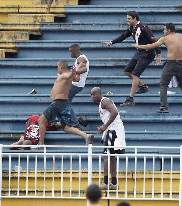 Vasco da Gama soccer fans beat up an Atletico Paranaense fan during their Brazilian championship match in Joinville