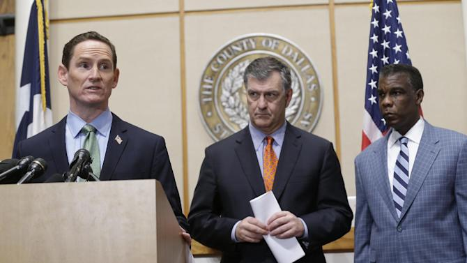 Dallas County Judge Clay Jenkins, left, speaks as Dallas Mayor Mike Rawlings, center, and Director of Dallas County Health and Human Services Zachary Thompson look on during a news conference Monday, Oct. 20, 2014, in Dallas. Ebola fears began to ease for some Monday as a monitoring period passed for those who had close contact with Thomas Eric Duncan, a victim of the disease, and after a cruise ship scare ended with the boat returning to port and a lab worker on board testing negative for the virus. (AP Photo/LM Otero)