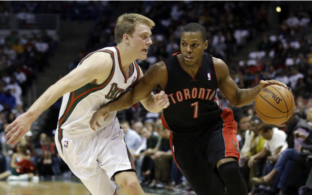 Toronto Raptors' Kyle Lowry drives past Milwaukee Bucks' Nate Wolters (6) during the first half of an NBA basketball game Saturday, Nov. 2, 2013, in Milwaukee
