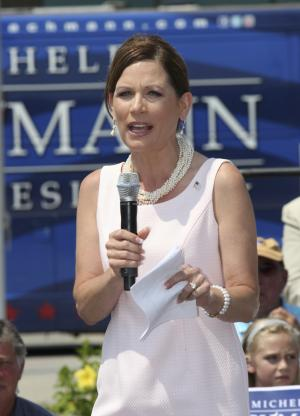"FILE - In this Aug. 19, 2011, file photo Republican presidential candidate Rep. Michele Bachmann, R-Minn. speaks outside the Myrtle Beach Convention Center in Myrtle Beach, S.C. An Associated Press-GfK poll released Friday, Aug. 26, 2011, found that two-thirds of Republicans and GOP-leaning independents are pleased with the party's presidential field, compared with just half in June. And they're paying more attention, with 52 percent expressing a ""great deal"" of interest in the GOP nomination fight, compared with 39 percent earlier this summer, after a period that saw Rick Perry enter the race and Bachmann win a test vote in the lead-off caucus state, threatening Mitt Romney's standing at the top of the pack. (AP Photo/Willis Glassgow, File)"