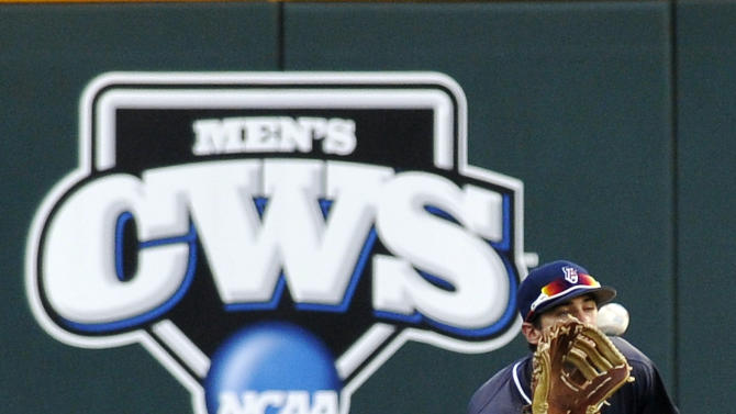 Arizona center fielder Joey Rickard catches a fly ball hit by South Carolina's Joey Pankake in the fourth inning of Game 2 of the NCAA College World Series baseball finals in Omaha, Neb., Monday, June 25, 2012. (AP Photo/Eric Francis)