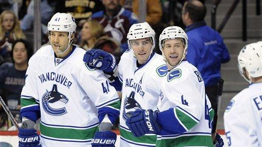 Canucks beat Avalanche 3-2 to take division lead