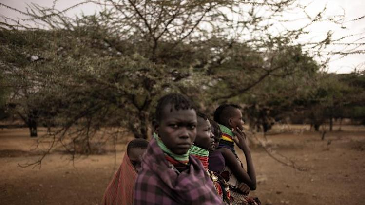 Turkana women gather outside a water installation in Koriabok, north of Lodwar (Turkana region) on March 13, 2014