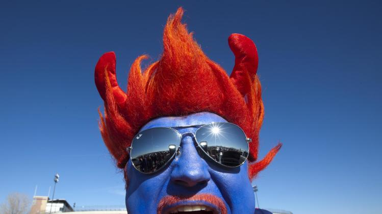 Boise State fan Jimmy Haun, of Boise, Idaho, stands outside the stadium before the Las Vegas Bowl NCAA college football game between Boise State and Washington on Saturday, Dec. 22, 2012, in Las Vegas. (AP Photo/Idaho Statesman, Darin Oswald) LOCAL TV OUT (KTVB 7)
