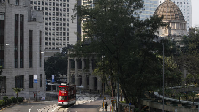 In this Jan. 11, 2013 photo, a tram runs in Central in downtown Hong Kong. Hop aboard the century-old tram system for an old-fashioned ride through the neighborhoods along the length of the northern edge of the island. (AP Photo/Kin Cheung)