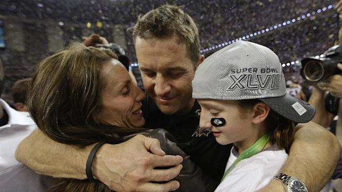 Baltimore Ravens head coach John Harbaugh hugs his wife Ingrid, left, and daughter Alison after defeating the San Francisco 49ers 34-31 in the NFL Super Bowl XLVII football game, Sunday, Feb. 3, 2013, in New Orleans. (AP Photo/Dave Martin)