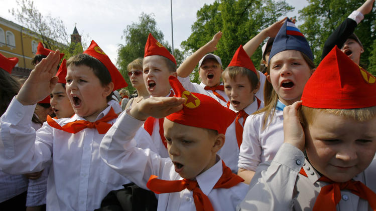 FILE - In this May 19, 2007 file photo, teenagers, members of the Young Pioneers, salute during a ceremony of joining the organization in Moscow. When Anders Behring Breivik, the far-right suspect in the massacre of 77 people in Norway, pulled his right hand to his chest and then thrust his arm out with a clenched fist after an Oslo courtroom guard removed his handcuffs on Monday, April 16, 2012, it was hardly the first time such a salute has been flashed. (AP Photo/Misha Japaridze, File)