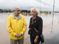 Nova Scotia Justice Minister Ross Landry, left, and Truro-Bible Hill Member of the Legislative Assembly Lenore Zann tour flooded areas after dikes on the Salmon River and North River gave way in Truro, Nova Scotia on Monday, Sept. 10, 2012. The area is under a rainfall warning as Tropical Storm Leslie churns toward Atlantic Canada. Leslie is expected to make landfall in Newfoundland bringing heavy rain and high winds. (AP Photo/The Canadian Press, Andrew Vaughan)