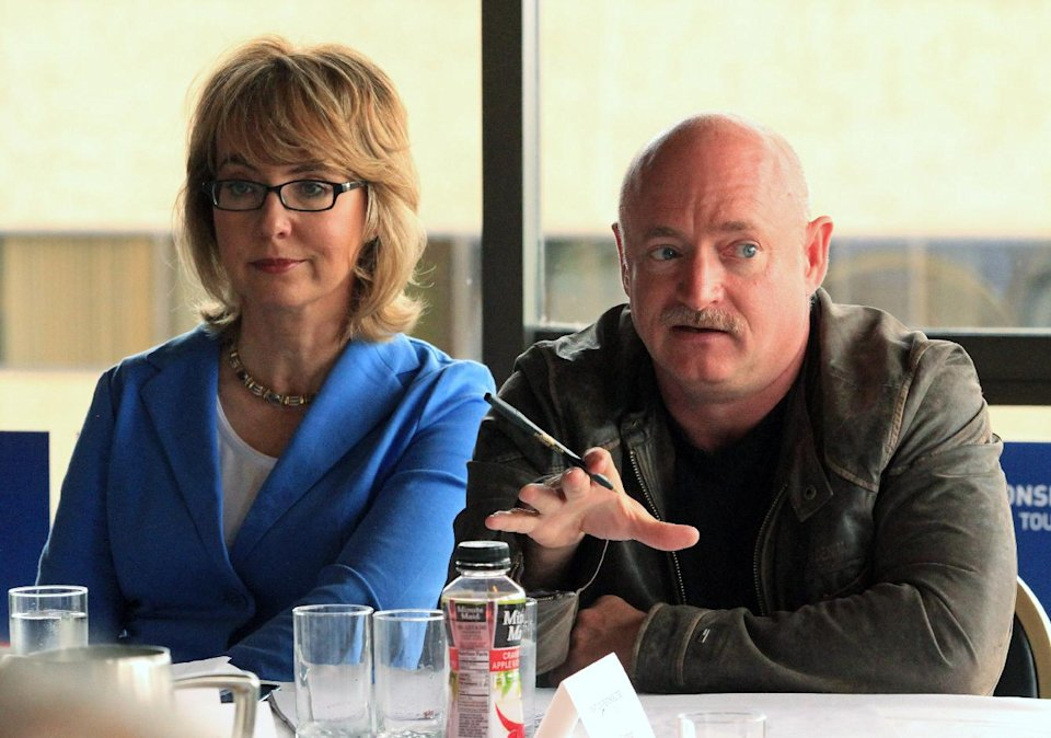 "Former U.S. Rep. Gabrielle Giffords, D-Ariz., and her husband, former astronaut Mark Kelly, speak to Alaska gun owners at a roundtable meeting in the Captain Cook Hotel on Tuesday, July 2, 2013, in Anchorage, Alaska. Giffords and Kelly are in Alaska as part of a seven-state ""Rights and Responsibilities Tour"" urging members of Congress to expand background checks on gun sales. Giffords, who survived a 2011 assassination attempt, and Kelly founded Americans for Responsible Solutions. (AP Photo/Dan Joling)"