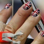 Britain's Alison Williamson sports fingernails painted in the colors of the Union Jack during the women's archery individual ranking round of the London 2012 Olympics Games at the Lords Cricket Ground in London
