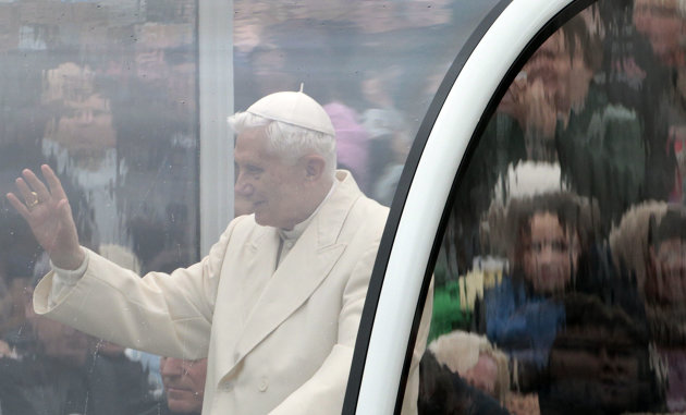 FILE - In this Wednesday, Oct. 31, 2012 file photo, Pope Benedict XVI is seen behind a window of his pope-mobile as he delivers his blessing to faithful gathered in St. Peter's Square for his general audience, at the Vatican. Benedict always cast himself as the reluctant pope, a shy bookworm who preferred solitary walks in the Alps to the public glare and the majesty of Vatican pageantry. But once in office, he never shied from charting the Catholic Church on the course he thought it needed _ a determination reflected in his stunning announcement Monday that he would be the first pope to resign since 1415. (AP Photo/Gregorio Borgia)