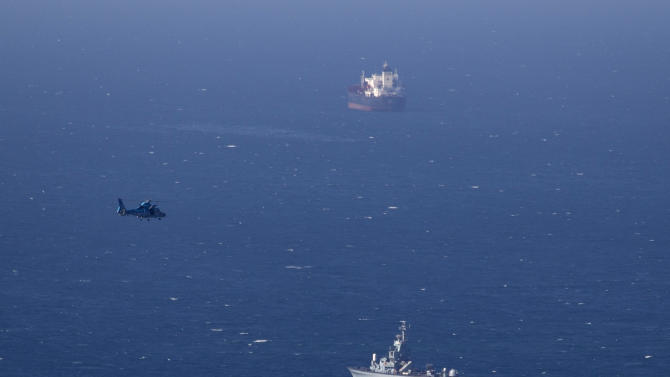 An Israeli military naval ship and an Israeli air force helicopter operate off the coast of Haifa , northern Israel, Thursday, April 25, 2013.  Israel shot down a drone Thursday as it approached the country's northern coast, the military said. Suspicion immediately fell on the Hezbollah militant group in Lebanon. The incident was likely to raise already heightened tensions between Israel and Hezbollah, a bitter enemy that battled Israel to a stalemate during a monthlong war in 2006. (AP Photo/Ariel Schalit)