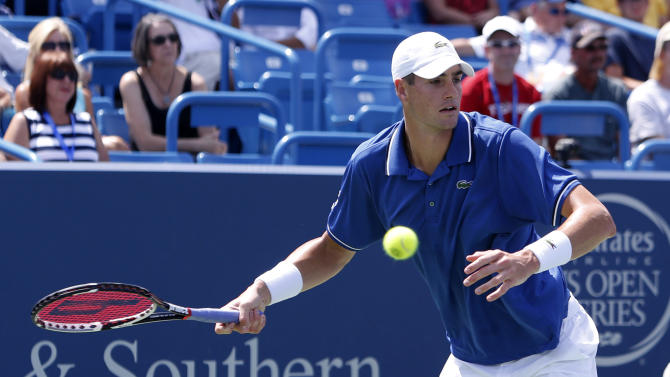 John Isner, from the United States, returns a shot from Juan Martin Del Potro, from Argentina, during a semi-final match at the Western & Southern Open tennis tournament, Saturday, Aug. 17, 2013, in Mason, Ohio. (AP Photo/David Kohl)