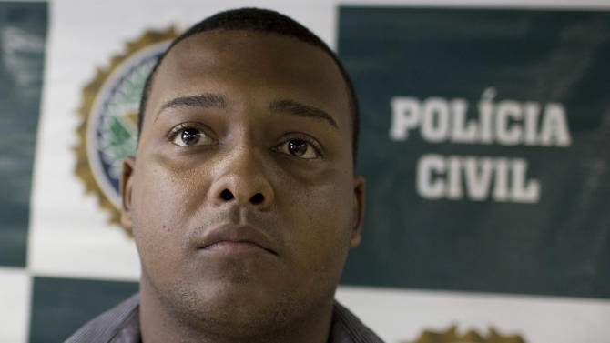 Suspect Carlos Armando Costa dos Santos is presented to the press at Special Police Unit for Tourism Support (DEAT) after being arrested for allegedly attacking tourists in Rio de Janeiro, Brazil, Tuesday, April 2, 2013. An American woman was gang raped and beaten aboard a public transport van while her French boyfriend was shackled, hit with a crowbar and forced to watch the attacks after the pair boarded the vehicle in Rio de Janeiro's showcase Copacabana beach neighborhood, police said.  The attacks took place over six hours starting shortly after midnight on Saturday. (AP Photo/Felipe Dana)