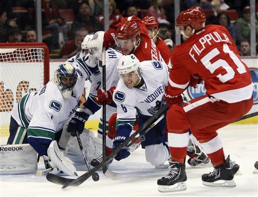 Brunner has 4 points in Red Wings' rout of Canucks