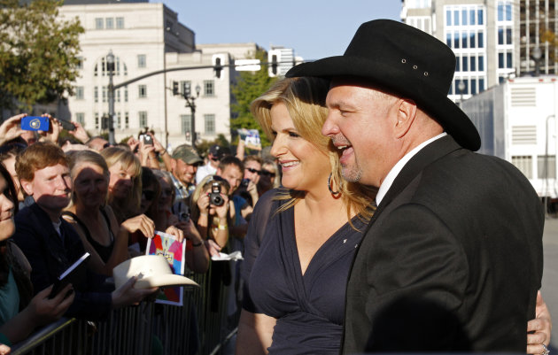 Garth Brooks and Trisha Yearwood greet fans the Country Music Hall of Fame Inductions on Sunday, Oct. 21, 2012 in Nashville, Tenn. (Photo by Wade Payne/Invision/AP)