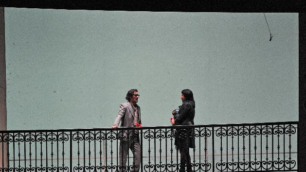 In this picture taken July 28, 2012, Piotr Beczala as Rodolfo the poet, and Anna Netrebko as Mimi perform during rehearsals for the opera 'La Boheme' by Italian composer Giacomo Puccini in Salzburg, Austria as part of the Salzburg Opera Festival. (AP Photo/dapd/Kerstin Joensson)