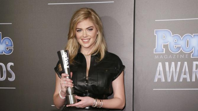 Model Kate Upton poses backstage with her People's Sexiest Woman Alive award at the People Magazine Awards in Beverly Hills