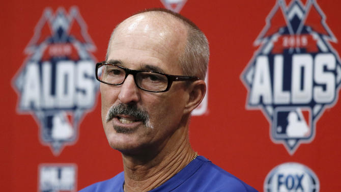 Texas Rangers pitching coach Mike Maddux responds to questions about starting pitcher Cole Hamels during a news conference Tuesday, Oct. 13, 2015, in Arlington, Texas. The Rangers will play the Toronto Blue Jays Wednesday in Game 5 of the baseball's ALDS. (AP Photo/Tony Gutierrez)