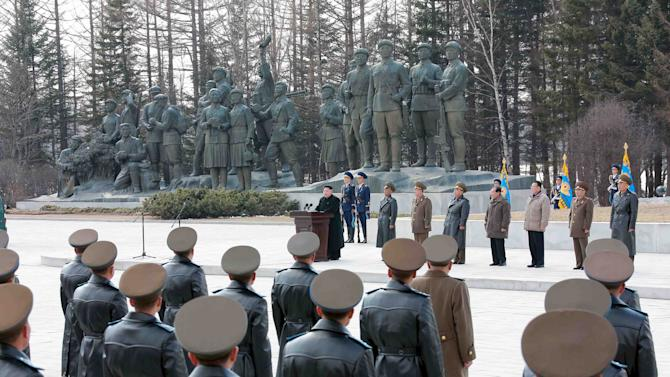 North Korean leader Kim Jong Un visits Korean People's Army pilots who have completed a tour of battle sites in the area of Mt Paektu