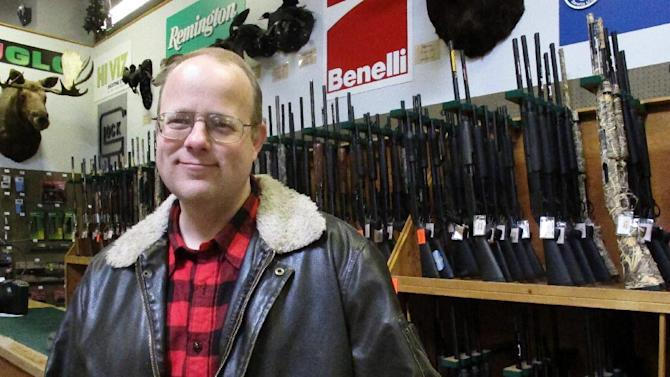 In this photo taken May 7, 2012, Charles Baird poses at a sportsman store in Anchorage, Alaska. Baird plans to live on Latouche Island in Alaska's Prince William Sound for a year homesteading and filming his adventure. He will be able to send short messages out, but will not receive any communications for a year until he's picked up in May 2013. (AP Photo/Mark Thiessen)