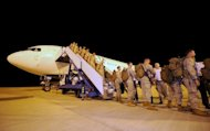 The first contingent of 200 US Marines to be deployed in Australia arrive at the RAAF Base Darwin in April 2012. Australian Defence Minister Stephen Smith has rejected a proposal to base a US nuclear aircraft carrier and other warships in the country, a move that would rankle key trade partner China