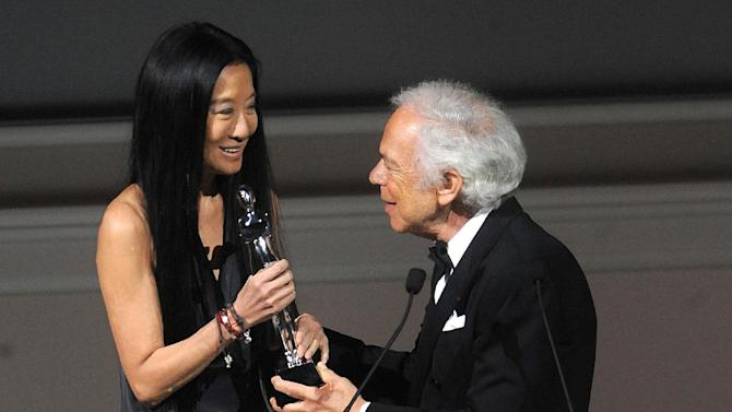 Designer Vera Wang, left, is presented with an award by fellow designer Ralph Lauren at the 2013 CFDA Fashion Awards at Alice Tully Hall on Monday, June 3, 2013 in New York. (Photo by Brad Barket/Invision/AP)