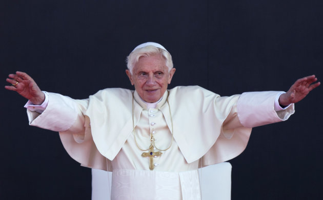 Pope Benedict XVI waves to people during his departure ceremony at the airport in Silao, Mexico, Monday, March 26, 2012. Pope Benedict XVI is departing Mexico and traveling to Cuba on Monday. (AP Photo/Alexandre Meneghini)