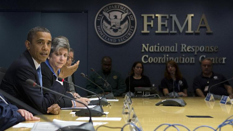 President Barack Obama, accompanied by Homeland Security Secretary Janet Napolitano, second from left, and others, speaks about superstorm Sandy during a visit to the Federal Emergency Management Agency (FEMA) Headquarters in Washington, Wednesday, Oct. 31, 2012. (AP Photo/Carolyn Kaster)