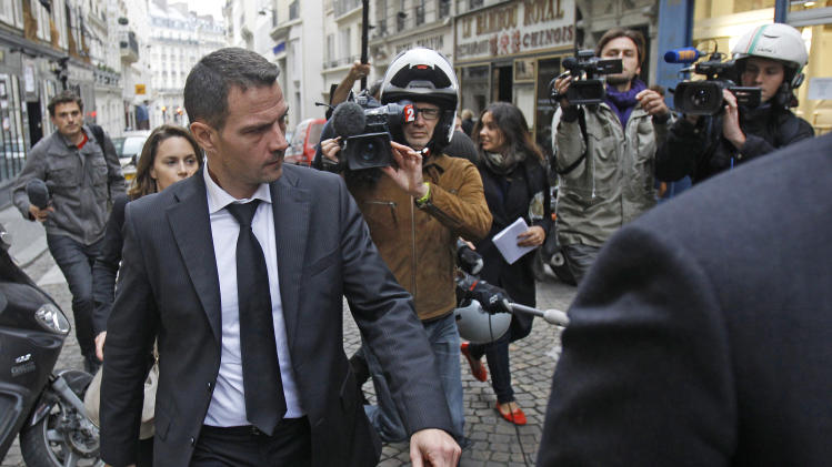 Former trader Jerome Kerviel leaves his lawyer's office in Paris, Wednesday, Oct. 24, 2012. The Paris appeals court on Wednesday ordered former Societe Generale trader Jerome Kerviel to spend three years in prison and pay back a staggering euro 4.9 billion (about $7 billion) in damages for one of the biggest trading frauds in history. (AP Photo/Remy de la Mauviniere)