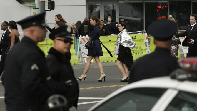 Extra police officers patrol outside the entrance to the 55th annual Grammy Awards in Los Angeles, Sunday, Feb. 10, 2013. An increase in law enforcement was on hand due to the continued manhunt for accused killer and fired Los Angeles police officer, Christopher Dorner. (AP Photo/Chris Carlson)