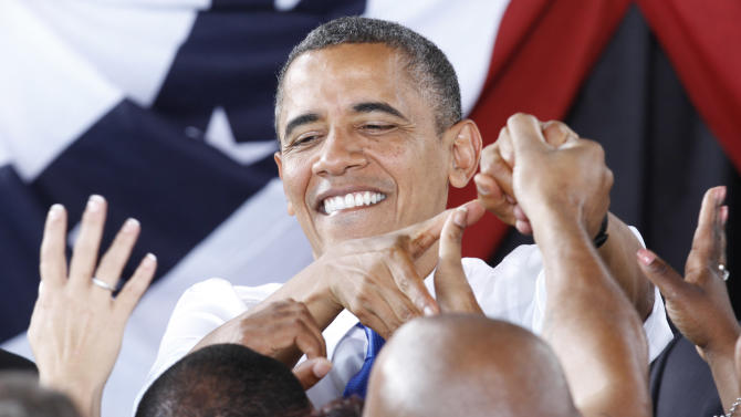 President Barack Obama greets supporters  during a rally in Virginia Beach, Va., Thursday, Sept. 27, 2012.   (AP Photo/Steve Helber)