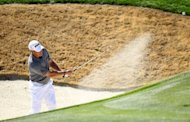 Lee Westwood of England hits a shot from a bunker on the second hole during the quarterfinal round of the World Golf Championships-Accenture Match Play Championship at the Ritz-Carlton Golf Club in Marana, Arizona. Rory McIlroy and Westwood, each seeking a title to become World No. 1, advanced to a semi-final showdown