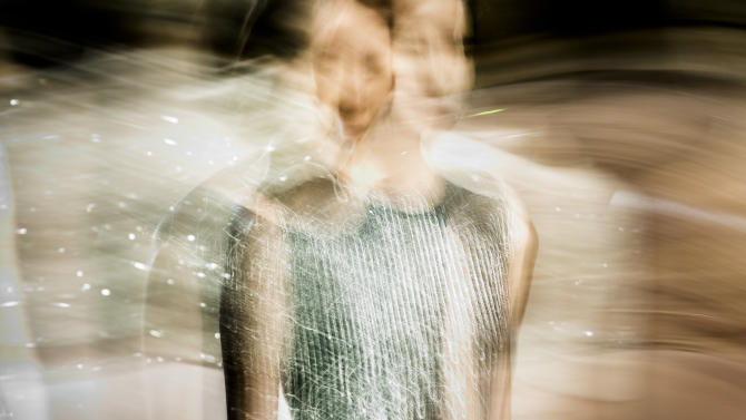 In this photo made with a long exposure, a model walks the runway at the Jenny Packham Fall 2013 fashion show during Fashion Week, Tuesday, Feb. 12, 2013, in New York. (AP Photo/John Minchillo)