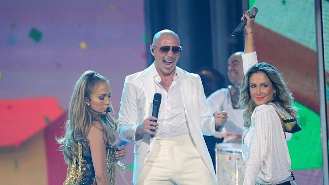 Jennifer Lopez, left, Pitbull, center, and Claudia Leitte, right, perform at the Billboard Music Awards at the MGM Grand Garden Arena on Sunday, May 18, 2014, in Las Vegas. (Photo by Chris Pizzello/Invision/AP)