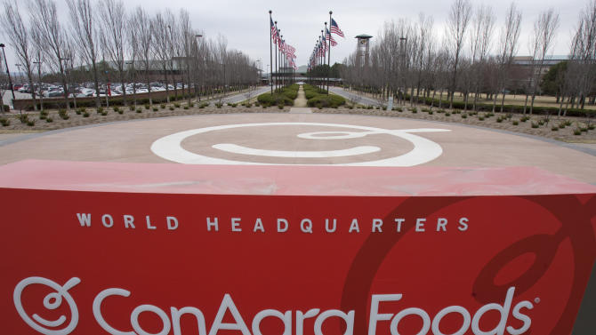 This March 21, 2011, file photo shows a sign for ConAgra Foods' world headquarters in Omaha, Neb. ConAgra Foods is buying private-label food producer Ralcorp for about $4.95 billion, which will make it the biggest private-label packaged food business in North America. ConAgra Foods Inc. said Tuesday, Nov. 27, 2012, that the deal is expected to close by March 31, 2013 and needs Ralcorp shareholder approval. (AP Photo/Nati Harnik, File)