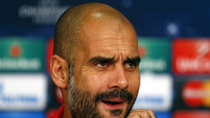 Munich's coach Pep Guardiola addresses a news conference before their Champions League group E soccer match against Manchester City, in Munich