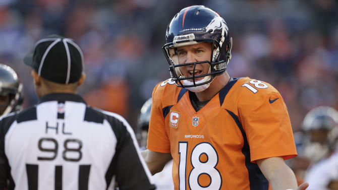 Denver Broncos quarterback Peyton Manning (18) comments to side judge Greg Bradley (98) in the second quarter of an NFL football game, Sunday, Dec. 2, 2012, in Denver. (AP Photo/Joe Mahoney)