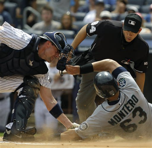 Ibanez homers, leads Garcia and Yanks over Seattle