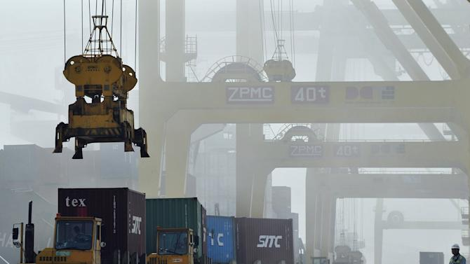 File picture of shipping containers loaded onto trucks at Dayaowan port in Dalian