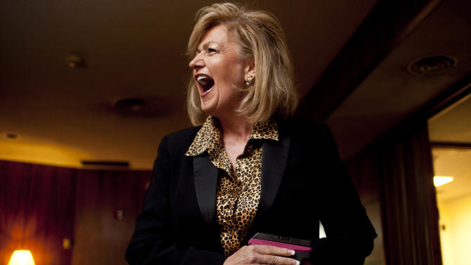 In this photo taken June 8, 2011, Sen. Lori Klein, R-Anthem, holds her Ruger LCP .380 in the Arizona State Senate members lounge in Phoenix. Klein, made national headlines when she brought a gun into the Arizona State Capitol days after the mass shooting in Tucson. Klein says she takes her concealed handgun everywhere and simply forgot that it was in her purse when she tried entering the house to hear Gov. Brewer's speech to lawmakers. (AP Photo/The Arizona Republic, Mark Henle)  MARICOPA COUNTY OUT; MAGS OUT; NO SALES