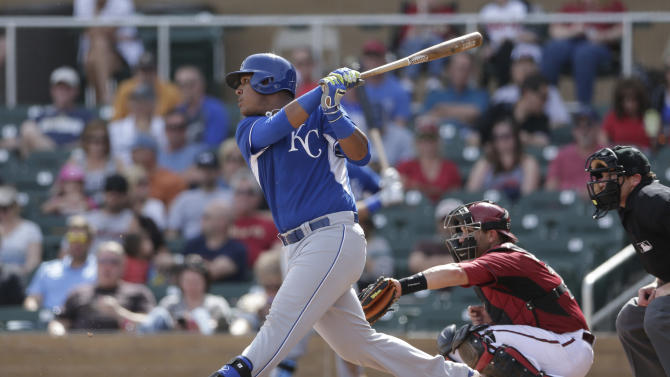 Kansas City Royals' Salvador Perez singles while batting against the Arizona Diamondbacks during the first inning of an exhibition spring training baseball game Wednesday, March 5, 2014, in Scottsdale, Ariz. (AP Photo/Gregory Bull)