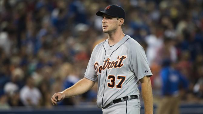 Detroit Tigers starting pitcher Max Scherzer walks back to his dugout after working against the Toronto Blue Jays during the sixth inning of a baseball game Wednesday, July 3, 2013, in Toronto. (AP Photo/The Canadian Press, Nathan Denette)