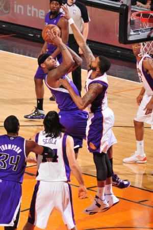 Cousins leads Kings past Suns, 117-103