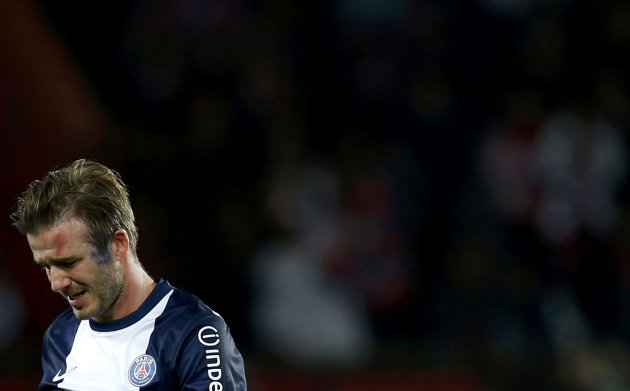 Paris Saint-Germain's Beckham breaks down in tears as he walks off pitch after being substituted in 81st minute during his team's French Ligue 1 soccer match against Brest in Paris