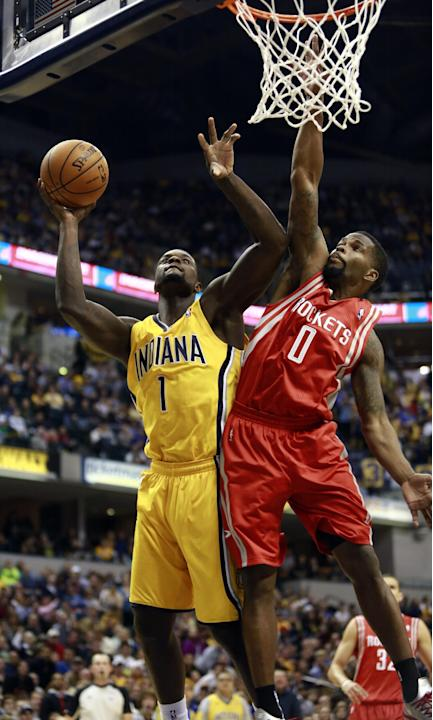 Indiana Pacers guard Lance Stephenson (1) shoots the basketball defended by Houston Rockets guard Aaron Brooks (0) in the second half of an NBA basketball game in Indianapolis, Friday, Dec. 20, 2013.