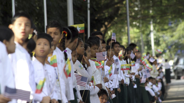 Myanmar students wave miniature Myanmar and American flags as they wait to welcome the arrival of U.S. President Barack Obama at Yangon International Airport on Monday, Nov. 19, 2012, in Yangon, Myanmar.  (AP Photo/Khin Maung Win)