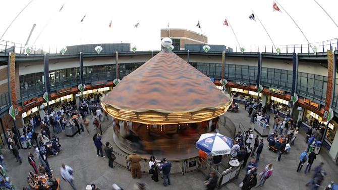 Fans ride the Comerica Carousel before the start of Game 3 of baseball's World Series between the San Francisco Giants and Detroit Tigers Saturday, Oct. 27, 2012, in Detroit. The Giants lead the series 2-0.  (AP Photo/Matt Slocum)